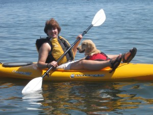Golden Retriever Dog and Woman in Kayak