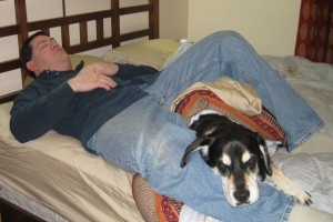 Man and Dog on bed.