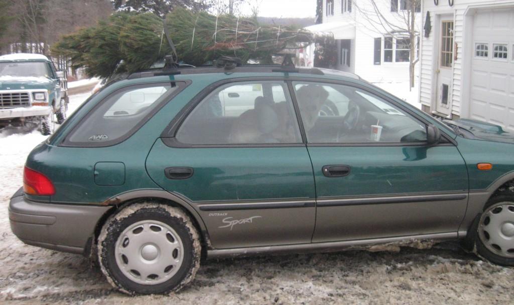 Christmas Tree on top of Subaru.
