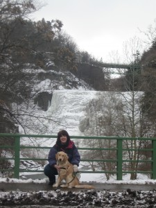 Golden Retriever and Woman in front of water falls