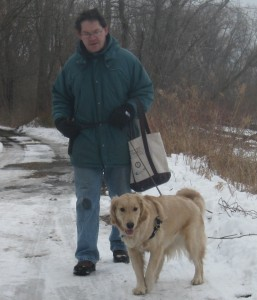 Golden Retriever and Man walking in the snow