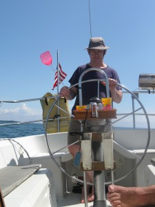 Mike at the wheel of the sailboat on Lake Ontario.