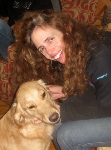 Honey the Golden Retriever gets an ear massage from her special friend Kirsten.