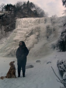 Honey the Golden Retriever stands in front of Ithaca Falls.