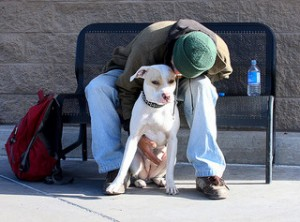 A homeless man and his dog.