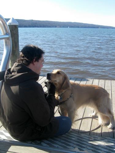 Honey the Golden Retriever loves Mike.