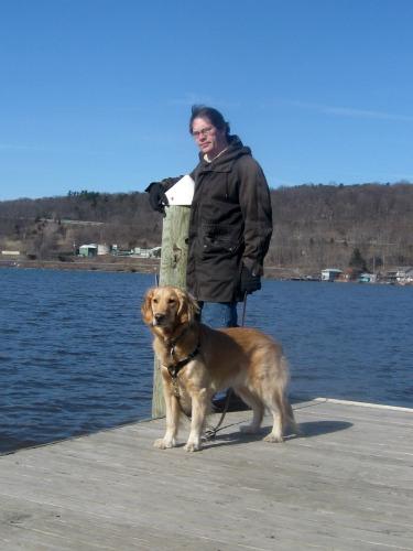 Honey the Golden Retriever poses on Cayuga Lake in Ithaca, NY.