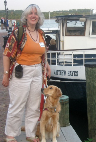 Honey the Golden Retrievers poses with Pamela in Alexandria, VA.