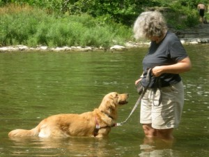 Pam and her dog save money by exercising in the creek.