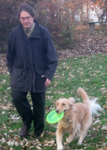 Mike walks with Honey, the easy dog.