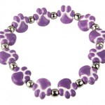Paw print bracelet supports fair trade and animal rescue.