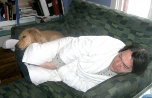 Honey the golden retriever cares for Mike when he's sick.