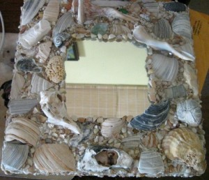 A mosaic mirror made with shells.