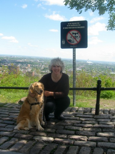 Honey the golden retriever and Pamela at Montreal overlook.