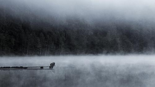 Fog rolls over the lake.