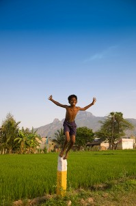 Happy boy jumps in India.