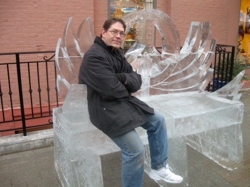 Man sitting on ice bench.