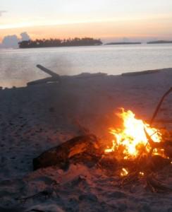 Burning garbage on the beach.