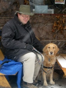 Honey the golden retriever dines outdoors with Mike.