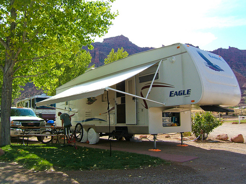 An RV set up at a camp site.