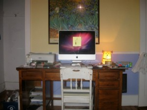 Cluttered desk before moving sale.