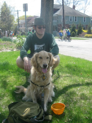 Honey the golden retriever with Mike at Streets Alive.