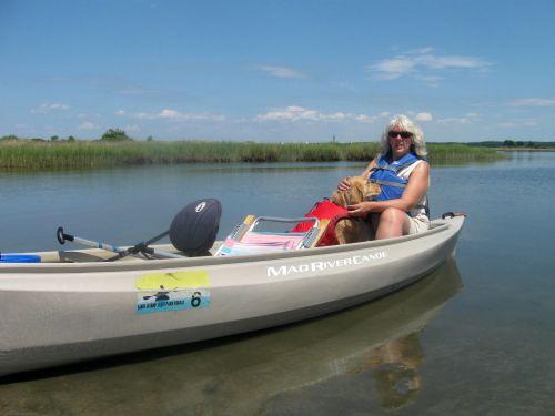 Honey the golden retriever with Pam in canoe.