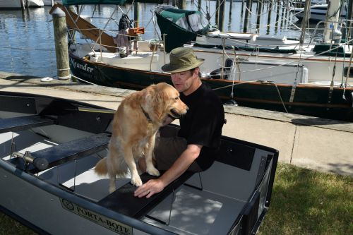 Honey the golden retriever puts her paws up on the seat.