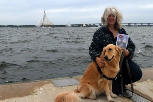 Honey the golden retriever on a windy day at the Skipjack Races.