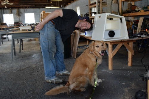 Honey the golden retriever and Mike show off the new composting head.