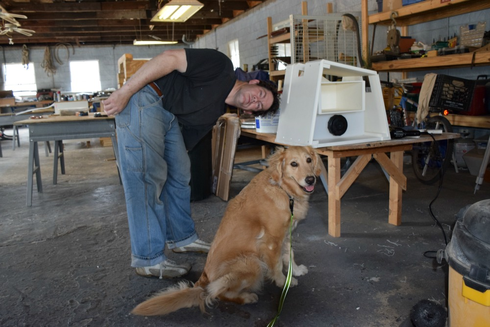 Honey the golden retriever poses with new boat equipment.