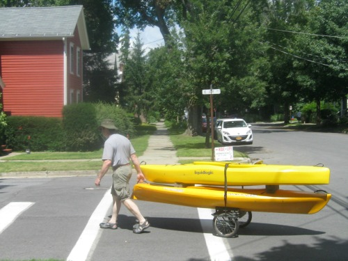 Mike pulls kayaks on a cart.
