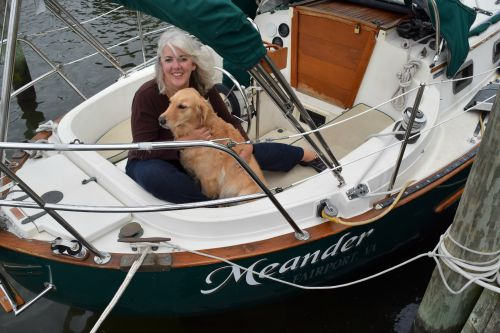 Honey the golden retriever is captain of Meander.