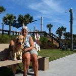Honey the golden retriever and Pam at Carolina Beach/