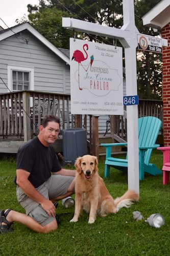 Honey the golden retriever with Mike at Chitterchats in Reedville.