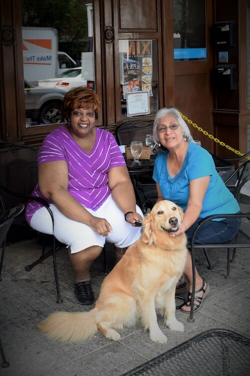 Honey the golden retriever with Glenda and Diana.