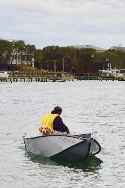 Mike and Honey dinghy to shore at Sloop Point Anchorage in Topsail Sound.
