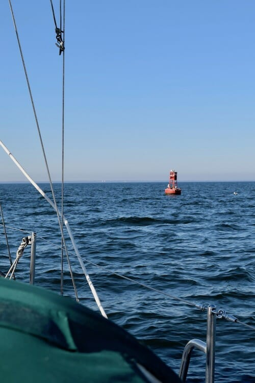 Red buoy on open water.