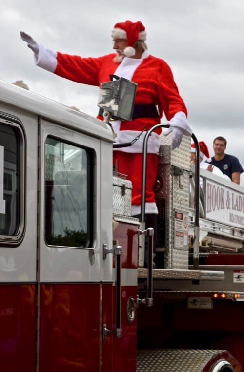 Learn about the wrong way to train your dog with treats. (Santa Claus arrives on a fire truck in Beaufort, NC.)
