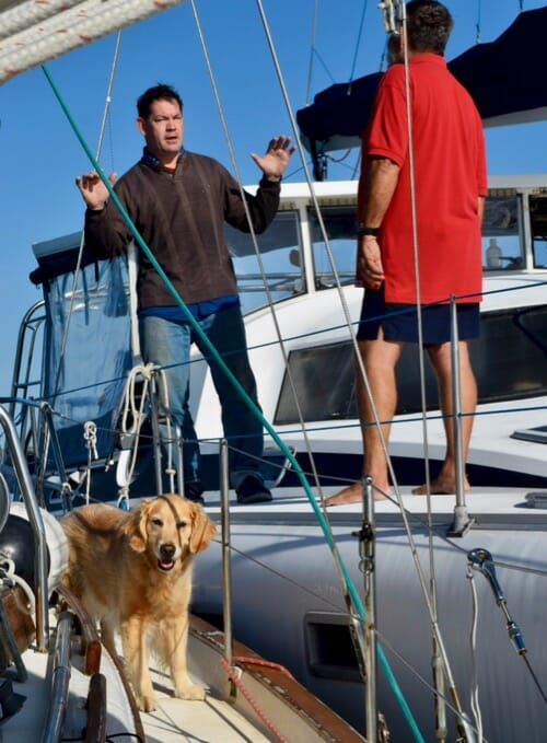 Review of 2018 on Meander (golden retriever on sailboat stuck to catamaran with two men)